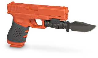 Photo of pistol bayonet on an orange Glock training pistol